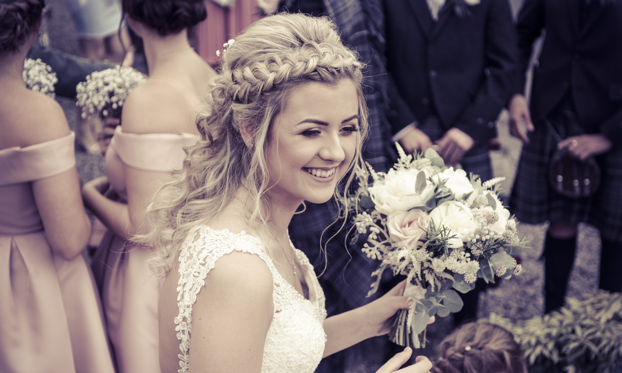 Bride with flowers by Edinburgh Wedding Photographer Ewan Mathers