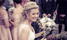 Bride with flowers by Edinburgh Wedding Photographer Ewan Mathers