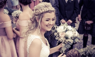 Bride with flowers by Highland Wedding Photographer Ewan Mathers