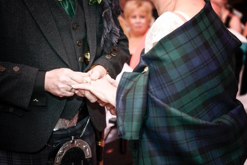 Exchanging Rings by Highland Wedding Photographer Ewan Mathers